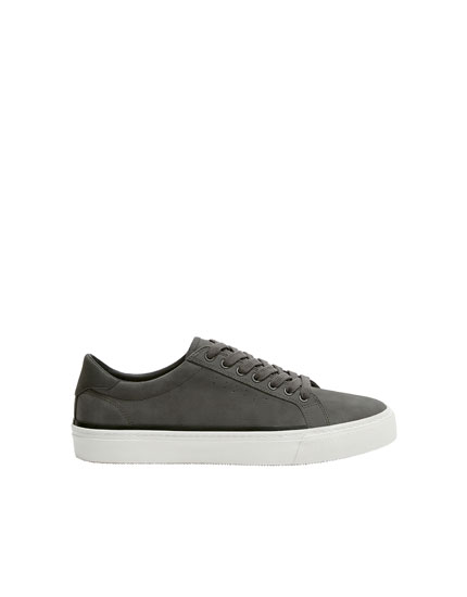 Trainers with perforated vamp