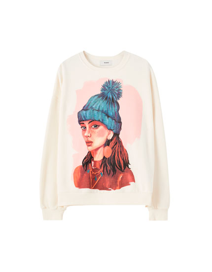 Sweatshirt featuring an illustration of a girl with a hat