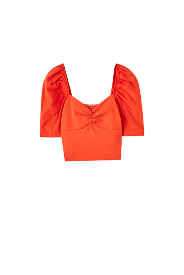 Coral top with puff sleeves