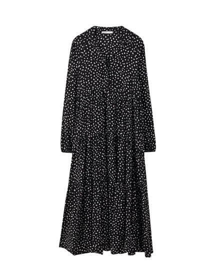 Polka dot dress with voluminous panelling