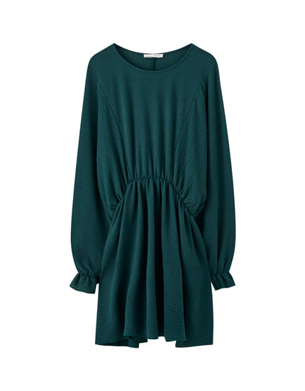 Green dress with voluminous sleeves