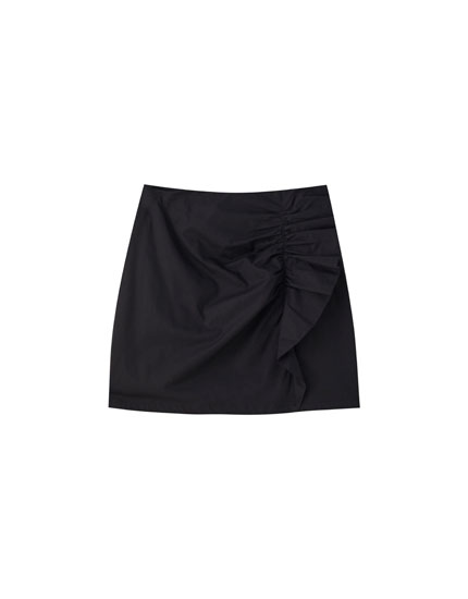 Pleated mini skirt with side ruffle