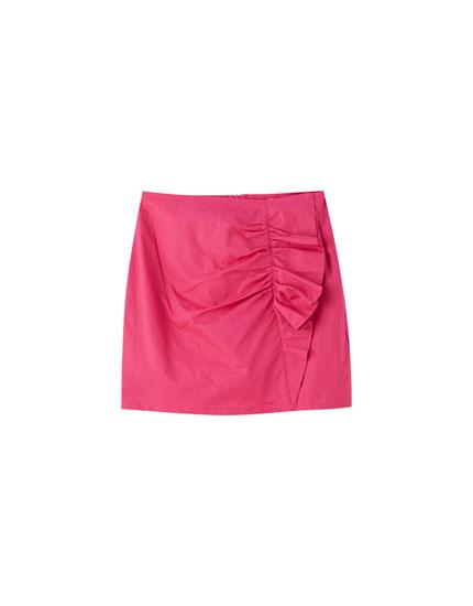 Φούξια μίνι φούστα με βολάν στο πλάι