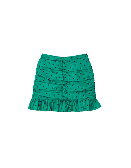 Green polka dot draped mini skirt
