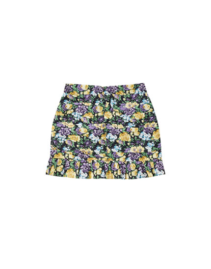 Ruffled printed mini skirt in draped fabric