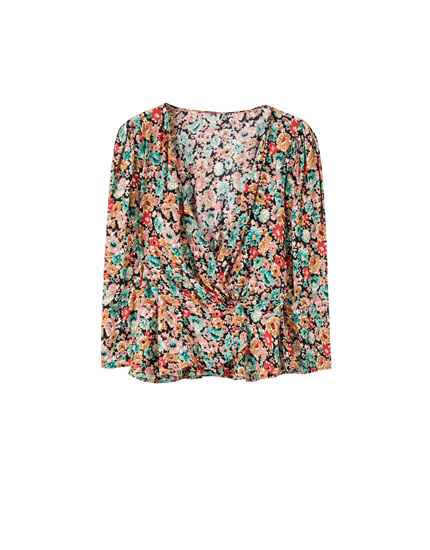 Wrap blouse with voluminous sleeves