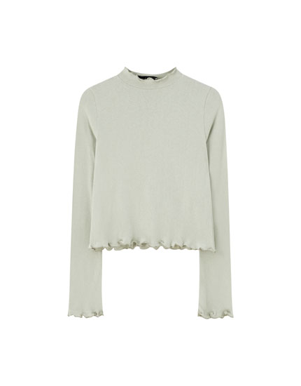 Lettuce-edge mock neck sweater