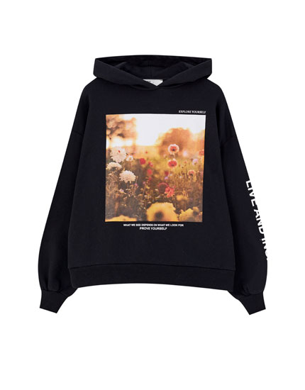 Black hoodie with flower print and slogan
