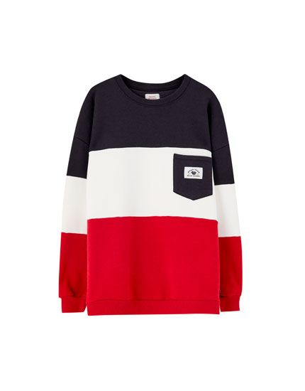 Sweat color block poche contrastante
