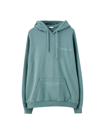 Green hoodie with contrast slogan