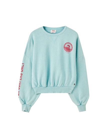Blue sweatshirt with contrast print