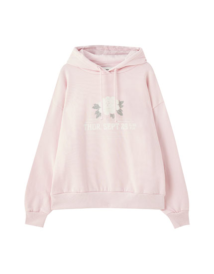Pink hoodie with floral illustration