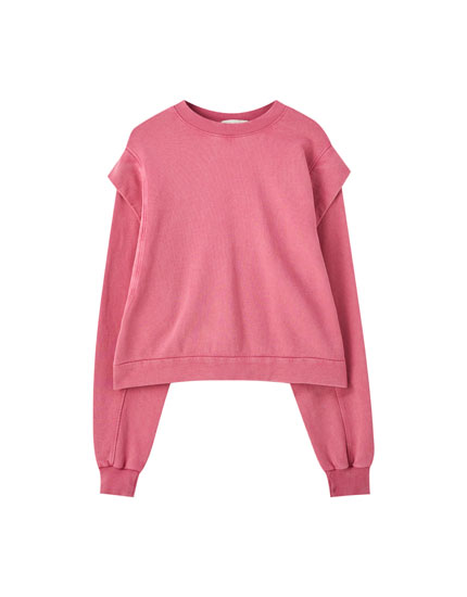 Faded pink sweatshirt with ruffles