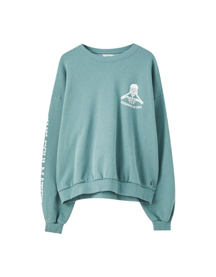 Green sweatshirt with skeleton illustration