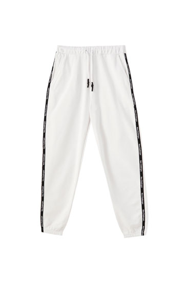 Joggers with contrast side stripes and slogan