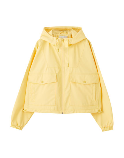 Cropped raincoat with hood and pockets