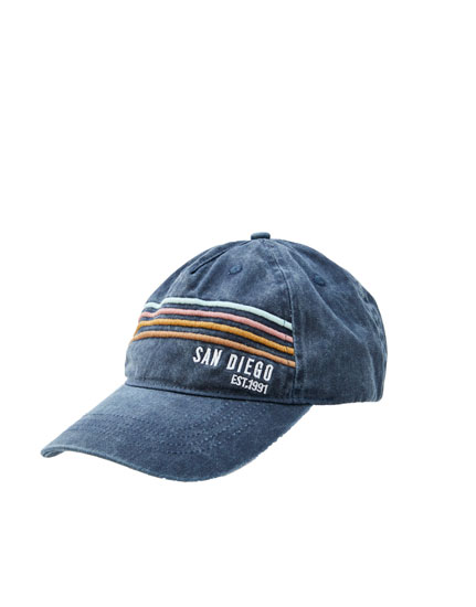 Blue cap with embroidered stripes