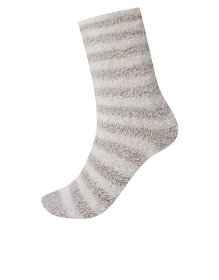 Fuzzy socks with grey stripes