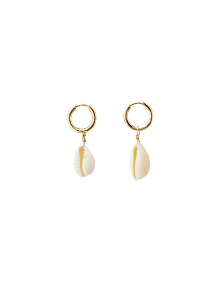Gold hoop earrings with seashells