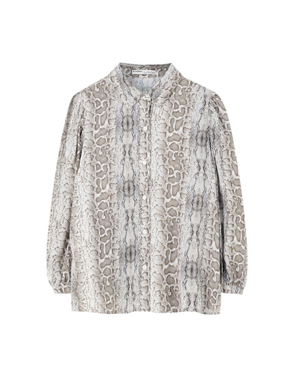 Snakeskin print top with puff sleeves