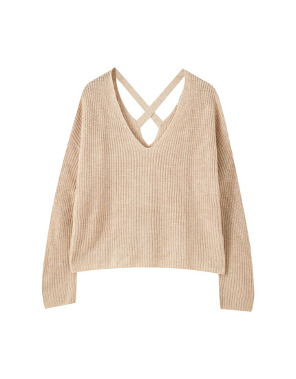 Sweater with criss-cross straps at the back
