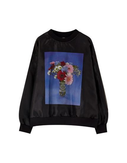Black sweatshirt with a vase of flowers illustration