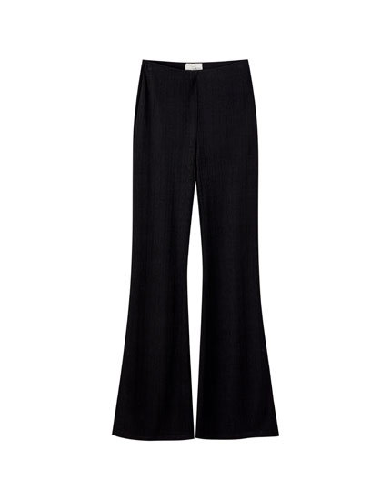 Ribbed black bell bottom trousers