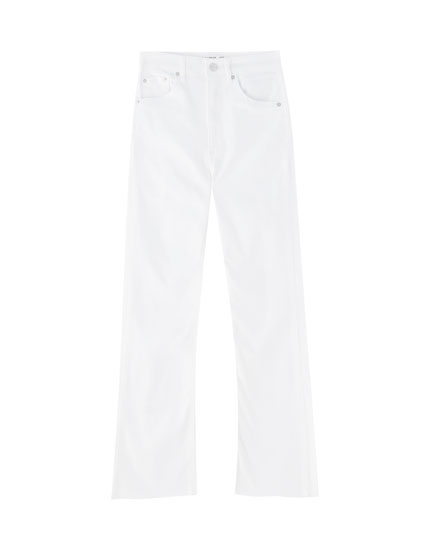 White tight-fitting flared jeans