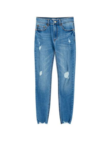 Jeans skinny tiro medio rotos