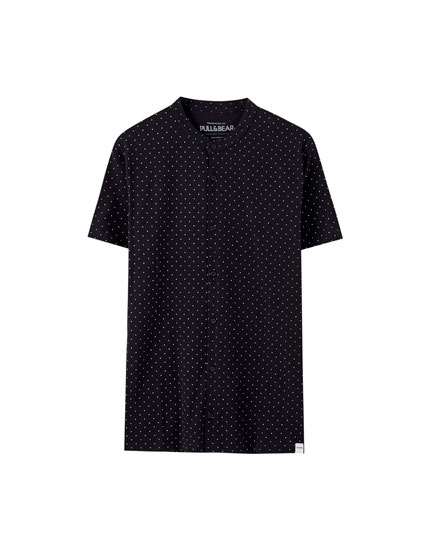 Polka dot polo shirt with a stand-up collar