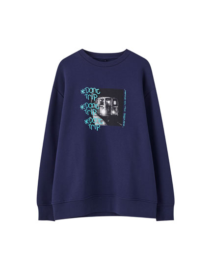 Blue sweatshirt with graffiti illustration