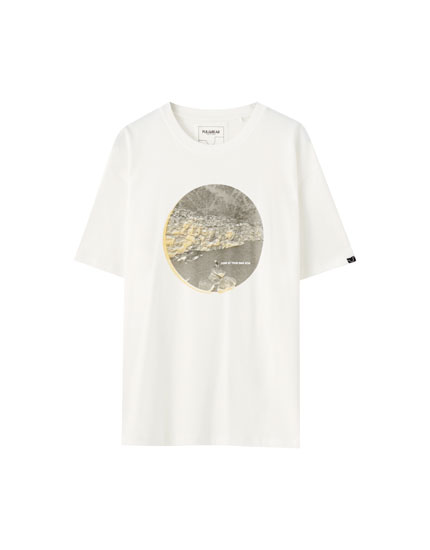 White T-shirt with a yellow illustration