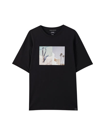 Black T-shirt with building illustration