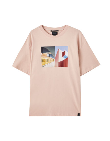 Pink T-shirt with building illustration