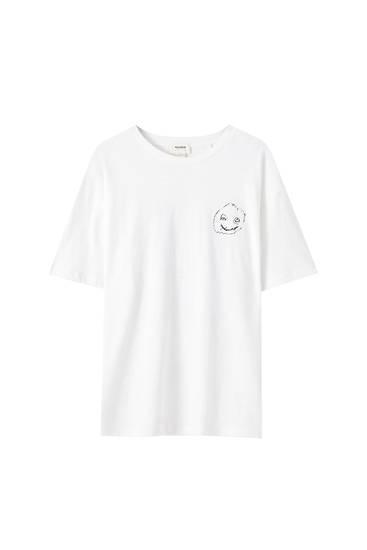 Λευκή μπλούζα με σκίτσο πρόσωπο