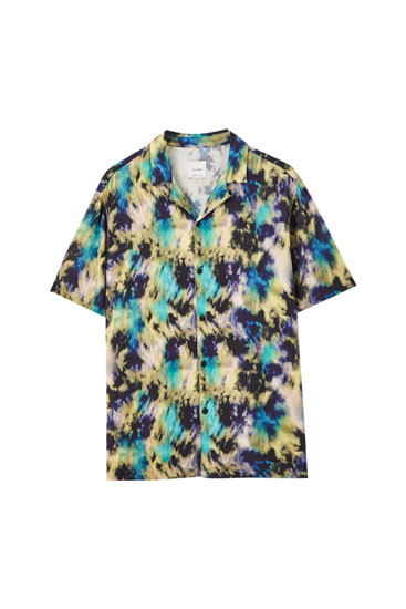 Blue shirt with multicoloured watercolour print