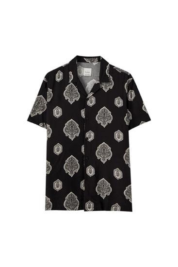 Black crest print shirt