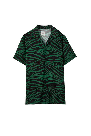 Green shirt with zebra print