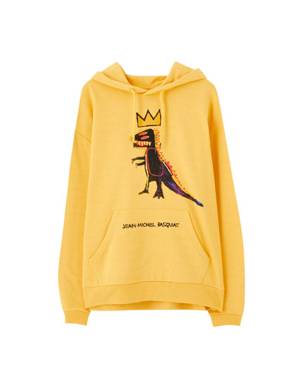 Yellow hoodie with Basquiat dinosaur print