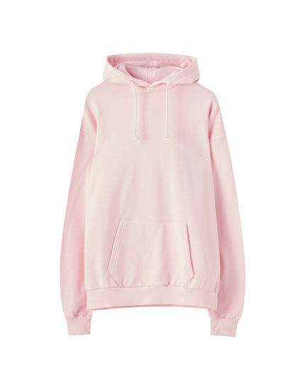 Pink hoodie with dragon illustration