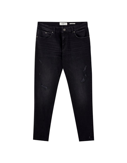 Faded black skinny jeans