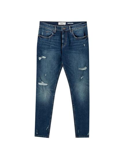 Greenish blue skinny jeans