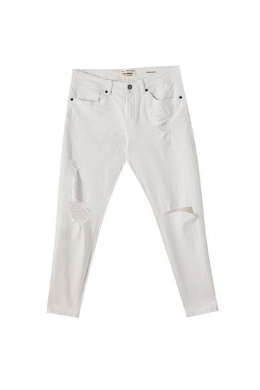Λευκό τζιν παντελόνι super skinny με σκισίματα