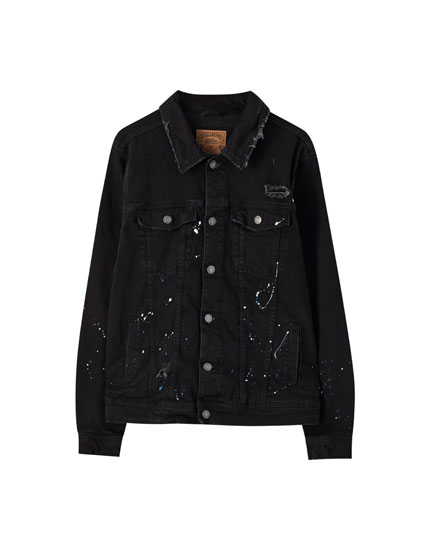 Black denim jacket with paint detail