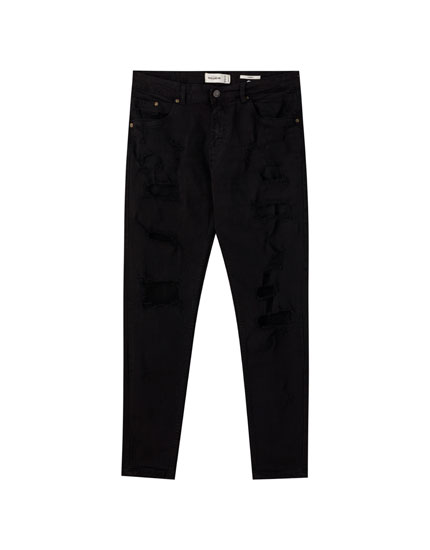 Black carrot fit jeans with large rips
