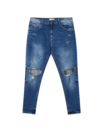 Blue ripped carrot fit jeans