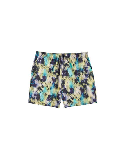 Blue Bermuda shorts with multicoloured watercolour print