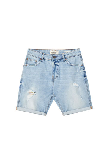 Light blue ripped Bermuda shorts