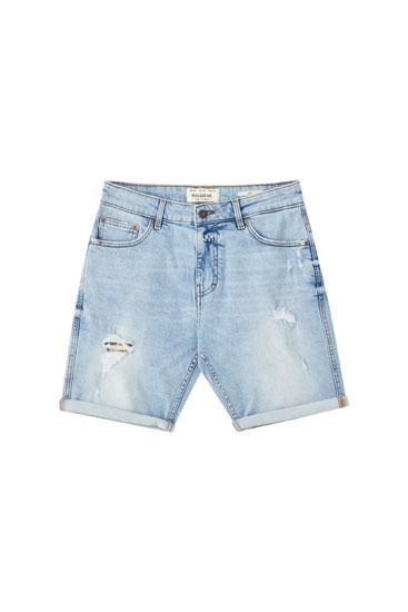 Light blue ripped Bermuda shorts