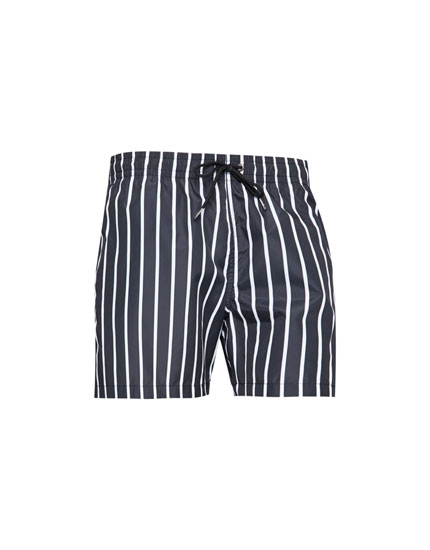 Black swimming trunks with vertical stripes